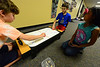 "Walt Hester | Trail Gazette Sawyer Basch plays air hockey with Gio Dumont while Sammi Daley watches after rehearsal for the Soggy Noodle Children'sTheatre on Wednesday. The Soggy Noodles will perform ""To Do or Not To Do, Shakespeare Gone Astray beginning Thursday, June 28."