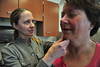 Dermatologist Kristin Baird examins a health fair visitor for signs of skin cancer on Saturday. In addition to encouraging visitors to check their health, the health fair was also a chance for newer staff, like Dr. Baird, to meet the community.