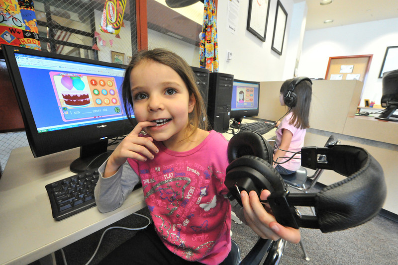 Maria Rojas Martinez, 6, plays a counting game on a computer in the Estes Park Elementary School library on Wednesday. The school's library had more than books for curious young minds.