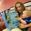 A baby is read to by his mother.<br /> <br /> Taken on July 4, 2014 by James Cadden.