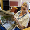 A senior enjoys the newspaper in the reading area.<br /> <br /> Taken on July 4, 2014 by James Cadden.