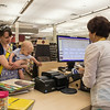 EPL Library Assistant, Ouafa Aatif, provides service to a customer.<br /> <br /> Taken on July 4, 2014 by James Cadden.