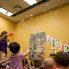 EPL Library Assistant, Kimberly McDonald, deploys bubbles, much to the delight of the children in a SSLL program held on July 4, 2014 at WMC.<br /> <br /> Photo by James Cadden.