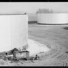 Cleaning oil storage tanks, Santa Fe Springs, CA, 1930