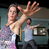 Kathy Ganeu, of Superior, left, works out during a Reflective Frequency Yoga class on Thursday, Jan. 24, at Sangha Studios on Front Street in Louisville. For a video about the yoga class go to www.dailycamera.com  Jeremy Papasso/ Camera