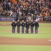 "World Series 2012, umpires during the singing of ""God Bless America"" sung by the San Francisco Police Department."