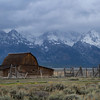 The John Moultan barn with the Teton mountains in the background.