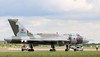 A tow around the apron heading back to the hangar<br /> By Correne Calow.
