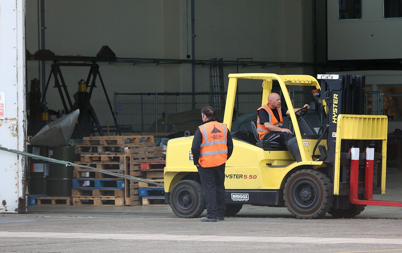 Browny closes the hangar doors with the aid of the forklift; watched over by Steve Hand<br /> By Correne Calow
