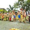 Dancers from Nimar enter the grounds of the Yap Living History Museum in Colonia