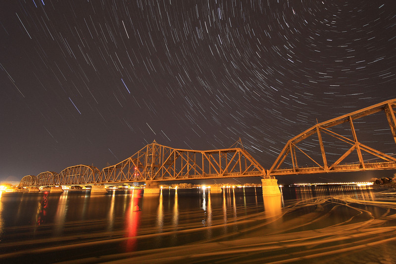 Star trails over the train bridge in Pierre.