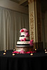 Portrait of a wedding cake with pink flower in the Cadre Building of Memphis, TN.