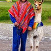 CUZCO. LITTLE BOY WITH A WHITE LLAMA.