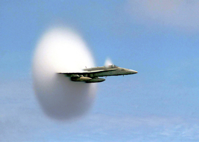 "990707-N-6483G-001<br /> ABOARD USS CONSTELLATION (July 7, 1999)-- Lieutenant Ron Candiloro, assigned to Fighter Squadron One Five One (VF-151), breaks the sound barrier in an F/A-18 ""Hornet"". VF-151 is currently deployed with the USS Constellation (CV 64) battlegroup.  U.S. Navy photo by Ensign John Gay.  (RELEASED)"