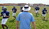 North Penn High School players at morning practice with coach Dick Beck.   Monday, August 11, 2014.   Photo by Geoff Patton