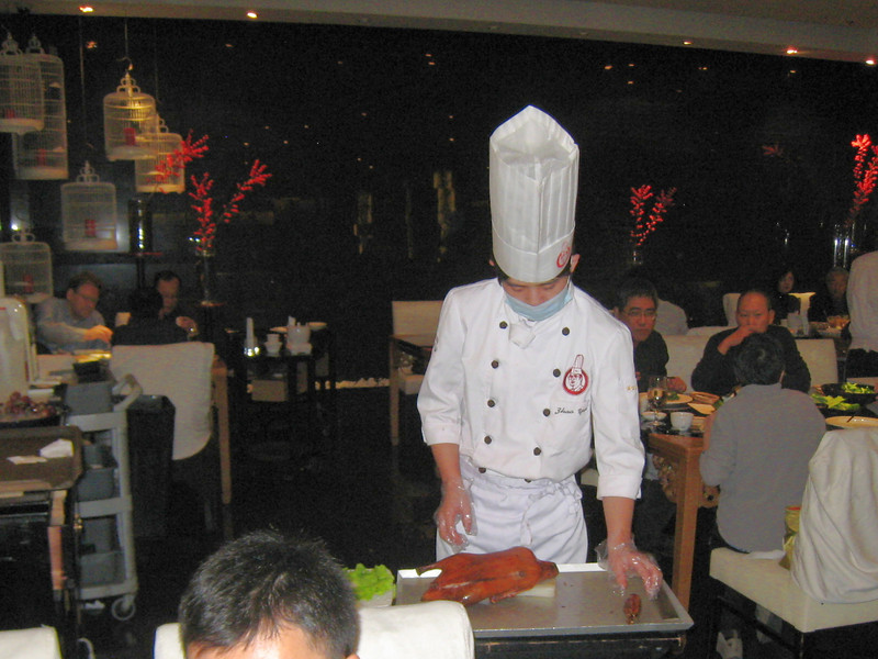 A chef prepares to carve our duck at the Da Dong Roast Duck restaurant in Beijing