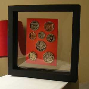 some examples of coins art bars medals within the floating frames