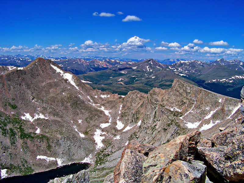 "A view of Mt. Bierstadt, the ""sawtooth"" ridge, Abyss Lake, and the distant Grays and Torreys Peaks, seen from the Mt. Evans west summit  ridge, Colorado Front Range."