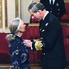 HRH Prince Charles invests Dr. Jane Goodall as Dame Commander of the British Empire in an Investiture Ceremony at Buckingham Palace. February 21, 2004.