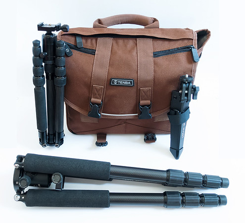 Three travel tripods and camera bag