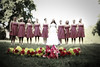 Stylized portrait of a bride with her bridesmaids and the bouquets spread out in front of them at Lichterman Nature Center in Memphis, TN.