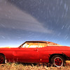 Star trails over an old Chevelle just outside of Pierre
