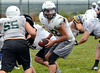 Pennridge quarterback Jagger Hartshorn hands off during morning practice.   Tuesday,  August 12, 2014.   Photo by Geoff Patton