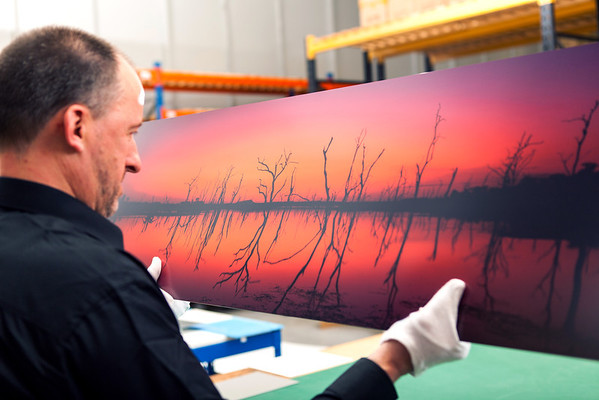 Inspecting Alumini prints at Loxley Colour