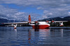 Forest Industries Martin Mars Water Bombers C-FLYK and C-FLYL at Sproat Lake, BC. (Reinhard Zinabold). Image: 907906.