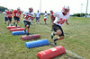 Members of the Souderton Area High School  football team at morning  practice.    Monday, August 11, 2014.    Photo by Geoff Patton