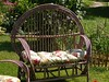 The loveseat & chairs take standard size patio cushions.  Here's a photo of our loveseat with cushion.