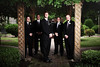 Stylized portrait of a groom and his groomsmen under a trellis at the Woodruff-Fontaine house in Memphis, TN.