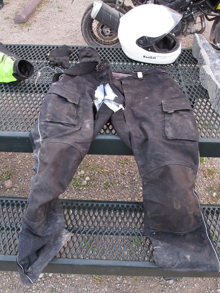 Day 3 - All the mounting / dismounting / lifting / squatting had caused my motorcycle pants to rip out in the crotch.  They were pretty old anyway, about 6 years and 100,000 miles on them probably.  They were already tattered, and stinky, and no longer waterproof.  I decided it was time to retire them honorably.