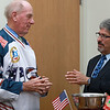Retired Fitchburg District court Judge Edward Reynolds played on the over 80 USA hockey team that played Canada in the Coupe Canada 150 Cup on Ottawa on October 28, 2017. The US bet Canada by a score of 3 to 2. Reynolds talks about the game with Mayor Stephen DiNatale when he visited Fitchburg City Hall on Thursday to show off the winners cup. SENTINEL & ENTERPRISE/JOHN LOVE