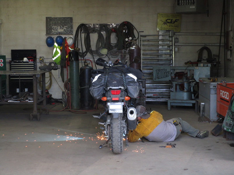 Day 3 - The owner of Certified Welding and Fabrication dropped his crane project to take ten minutes to weld up my bike.  Nice guy.