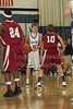 (23-Granville) Hunter Orth, (24-Heights) Anthony Mitchell, (10-Heights) John Righter - 1st Quarter - Tuesday, December 07, 2010 - Licking Heights Hornets at Granville Blue Aces - Junior Varsity Basketball