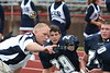 Coach Brian Davis offers guidance to (29) Jake Downey as (74) Trent Wills looks on. - August 27, 2005 Granville Blue Aces at Johnstown Johnnies, JV Football