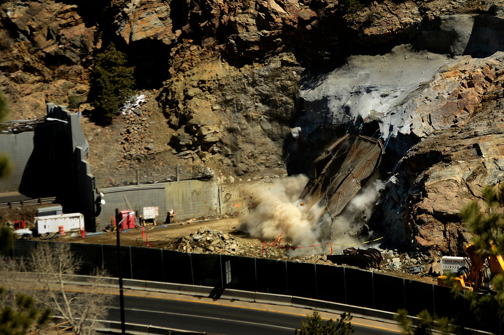 ". IDAHO SPRINGS, CO. - May 03: About 22,000 pounds of steel covering is blown out along with the solid rock as the first ""blast\"" at the west portal of the Twin Tunnels project in Idaho Springs signals the start the blasting season May 03, 2013 Idaho Springs, Colorado. (Photo By Joe Amon/The Denver Post)"