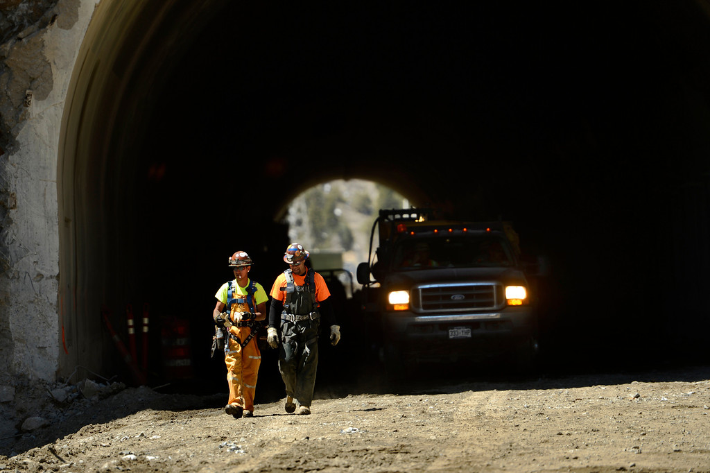 . IDAHO SPRINGS, CO. - May 03: Workers leave the east portal of the Twin Tunnels project in Idaho Springs. The project has shifts working 24 hours a day 6 days a week and the crews are tunneling from both ends May 03, 2013 Idaho Springs, Colorado. (Photo By Joe Amon/The Denver Post)