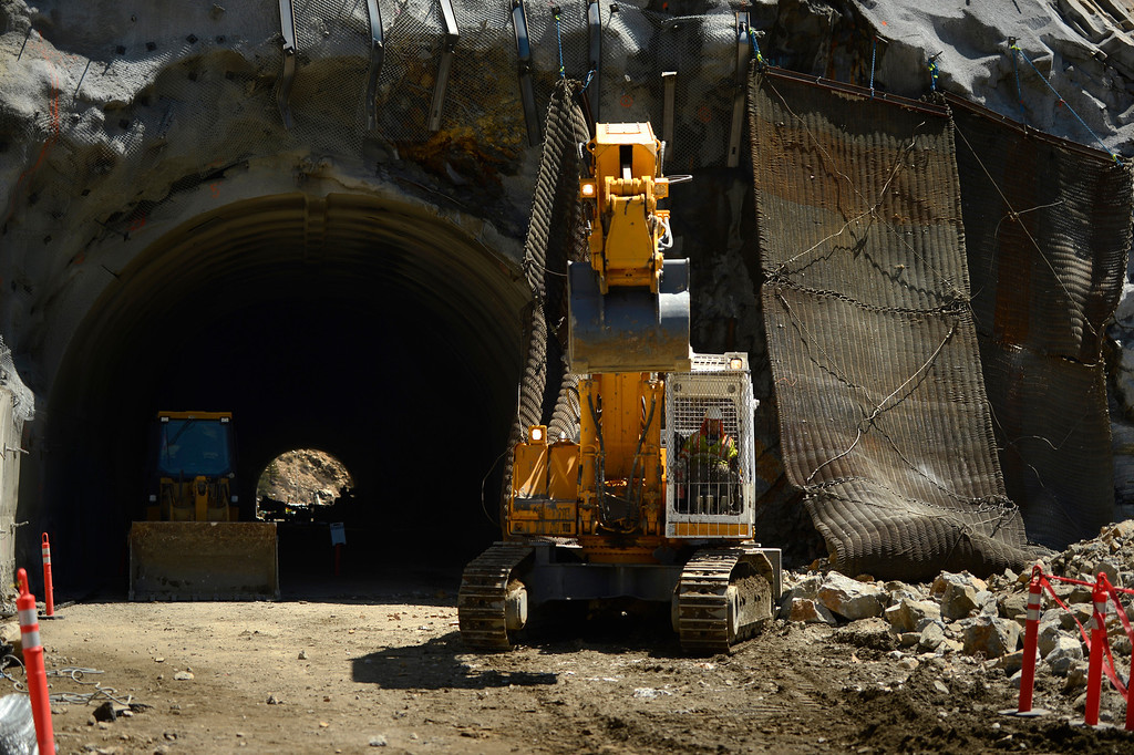 ". IDAHO SPRINGS, CO. - May 03:  Machine operators go after the rubble after the first ""blast\"" at the west portal of the Twin Tunnels project in Idaho Springs May 03, 2013 Idaho Springs, Colorado. (Photo By Joe Amon/The Denver Post)"