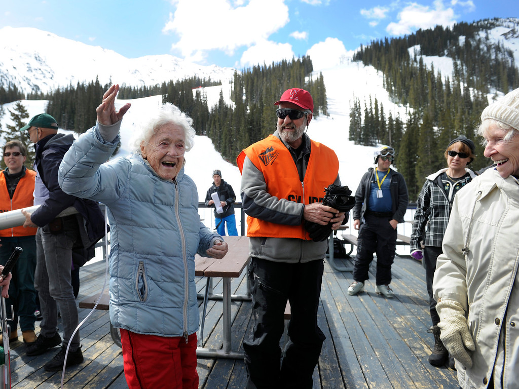 . SUMMIT COUNTY, CO - MAY 11: Elsa Bailey waves to everyone as she arrives for the festivities. Bailey has been a skier most of her life and after turning 100 years old, decided to celebrate by taking a run down a slope at Arapahoe Basin ski area. Dozens of family and friends joined her for a party and to witness this great physical feat. (Photo By Kathryn Scott Osler/The Denver Post)
