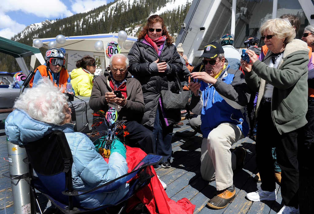 . SUMMIT COUNTY, CO - MAY 11: Like a celebrity, Elsa Bailey gets her photo taken after she arrives for the festivities. Bailey has been a skier most of her life and after turning 100 years old, decided to celebrate by taking a run down a slope at Arapahoe Basin ski area. Dozens of family and friends joined her for a party and to witness this great physical feat. (Photo By Kathryn Scott Osler/The Denver Post)