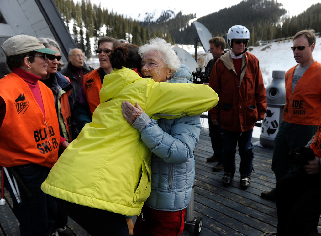 . SUMMIT COUNTY, CO - MAY 11: Elsa Bailey receives hugs all around as she arrives for the festivities. Bailey has been a skier most of her life and after turning 100 years old, decided to celebrate by taking a run down a slope at Arapahoe Basin ski area. Dozens of family and friends joined her for a party and to witness this great physical feat. (Photo By Kathryn Scott Osler/The Denver Post)