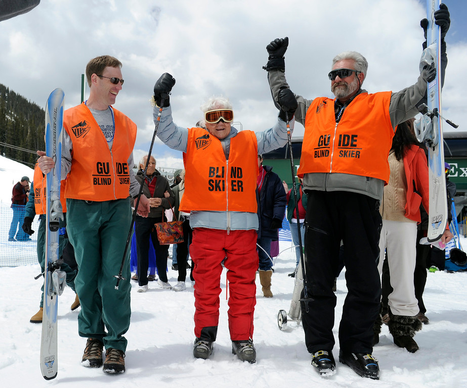 ". SUMMIT COUNTY, CO - MAY 11: After finishing her run, Elsa Bailey yells ""I did it\"" as her helpers Leo Bush, right, and John Ingham helping her celebrate. Bailey has been a skier most of her life and after turning 100 years old, decided to celebrate by taking a run down a slope at Arapahoe Basin ski area. Dozens of family and friends joined her for a party and to witness this great physical feat. (Photo By Kathryn Scott Osler/The Denver Post)"
