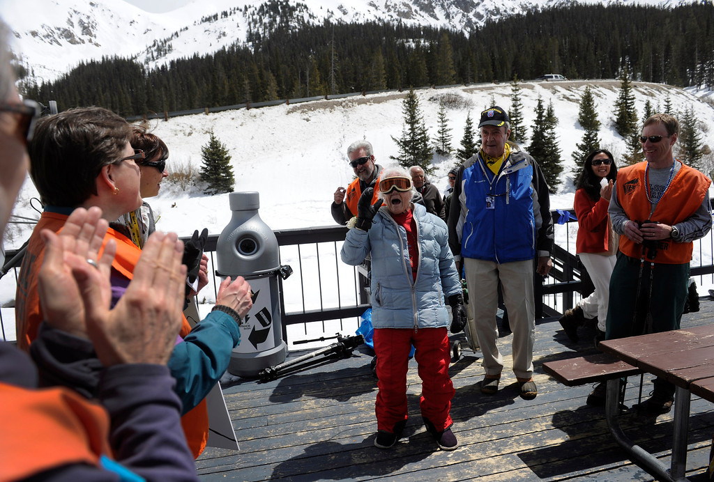 . SUMMIT COUNTY, CO - MAY 11: Friends clap and cheer after Elsa Bailey returns to the lodge from her ski run. Bailey has been a skier most of her life and after turning 100 years old, decided to celebrate by taking a run down a slope at Arapahoe Basin ski area. Dozens of family and friends joined her for a party and to witness this great physical feat. (Photo By Kathryn Scott Osler/The Denver Post)