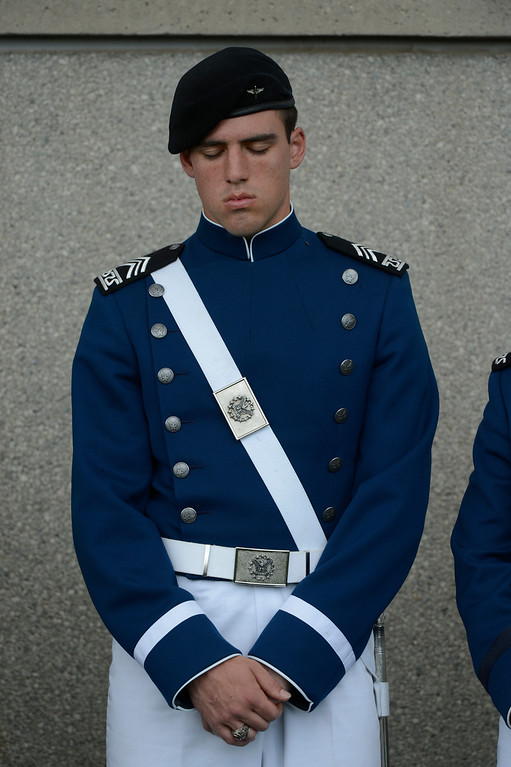 . A cadet bows his head for the invocation during the United States Air Force Academy graduation ceremony at Falcon Stadium in Colorado Springs, CO May 29, 2013.(Photo By Craig F. Walker/The Denver Post)