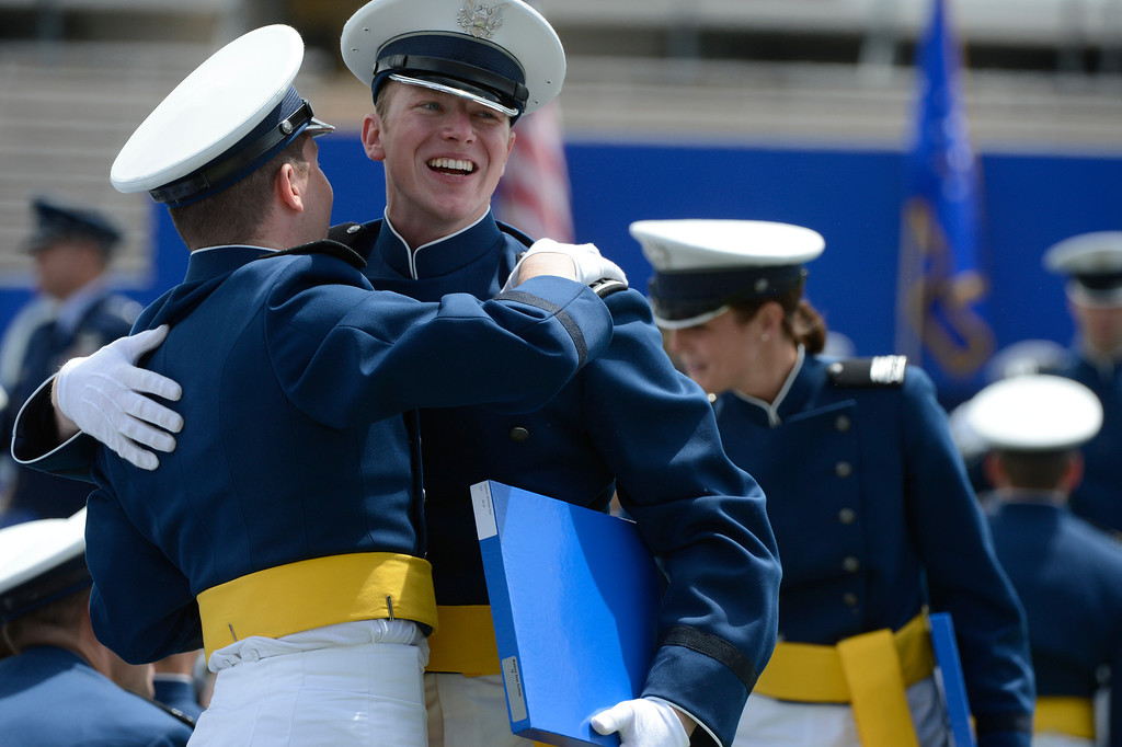 . Graduates celebrate after receiving their diplomas during the United States Air Force Academy graduation ceremony at Falcon Stadium in Colorado Springs, CO May 29, 2013.(Photo By Craig F. Walker/The Denver Post)