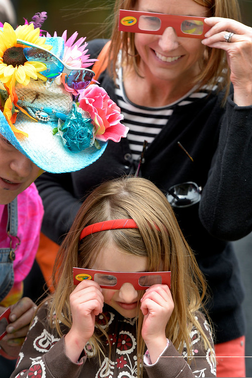 . DENVER, CO. - JUNE 01: Mythica von Griffyn, left, shares 3D glasses with Heather Leslie and her daughter, Amelia, during the Denver Chalk Art Festival on Larimer Square in Denver, CO June 01, 2013. More than 200 artists took part in the annual event which continues Sunday. Mythica says she uses color to offer a Three-dimensional effect. The festival features six award winning professionals  and a Youth Challenge presented by the Rocky Mountain College of Art & Design. (Photo By Craig F. Walker/The Denver Post)