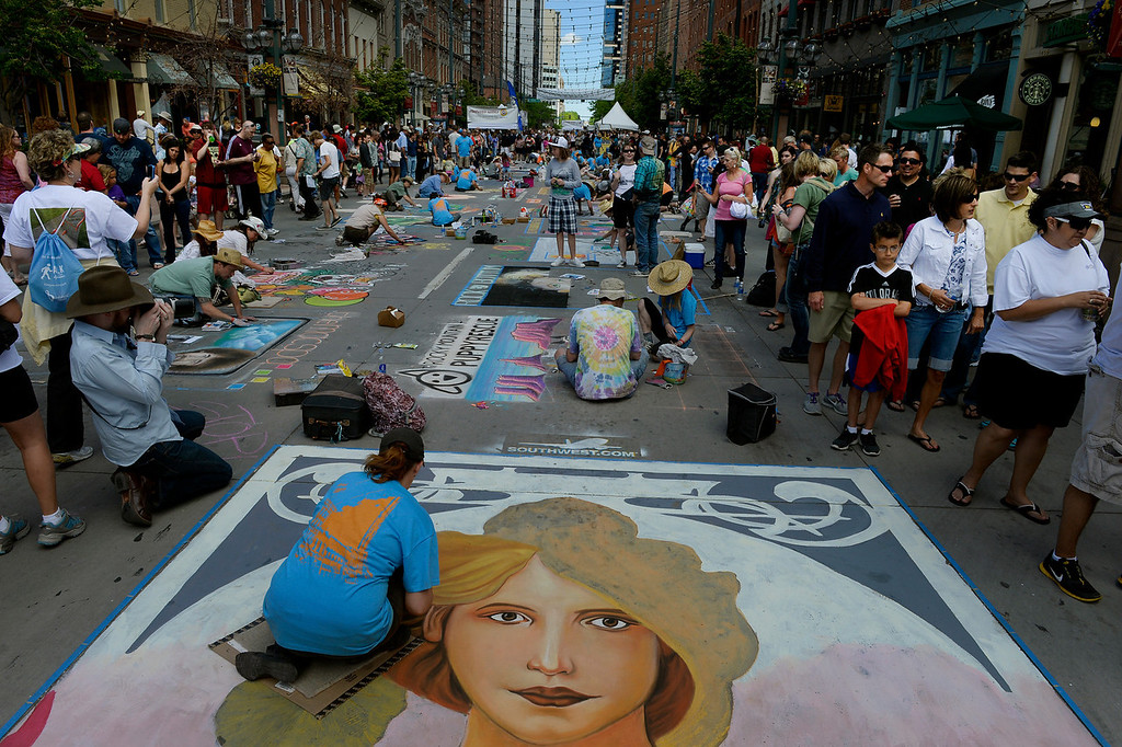 """. DENVER, CO. - JUNE 01: Dawn Wagner of, Thousand Oaks, CA, works on a reproduction of \""""Spring,\"""" originally by Alphonse Mucha, during the Denver Chalk Art Festival on Larimer Square in Denver, CO June 01, 2013. More than 200 artists took part in the annual event which continues Sunday. The festival features six award winning professionals  and a Youth Challenge presented by the Rocky Mountain College of Art & Design. Wagner is a featured artist this year and has been involved since the festival began. (Photo By Craig F. Walker/The Denver Post)"""