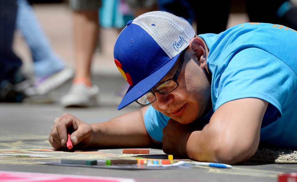 . DENVER, CO. - JUNE 01: Jon Rios, of Denver, works on an untitled piece during the Denver Chalk Art Festival on Larimer Square in Denver, CO June 01, 2013. More than 200 artists took part in the annual event which continues Sunday. The festival features six award winning professionals  and a Youth Challenge presented by the Rocky Mountain College of Art & Design. (Photo By Craig F. Walker/The Denver Post)